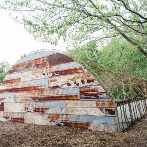 rusted tin siding on an open air greenhouse in Trenton GA