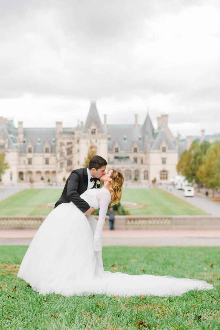 bride at Biltmore in princess dress and groom in black tie and suit