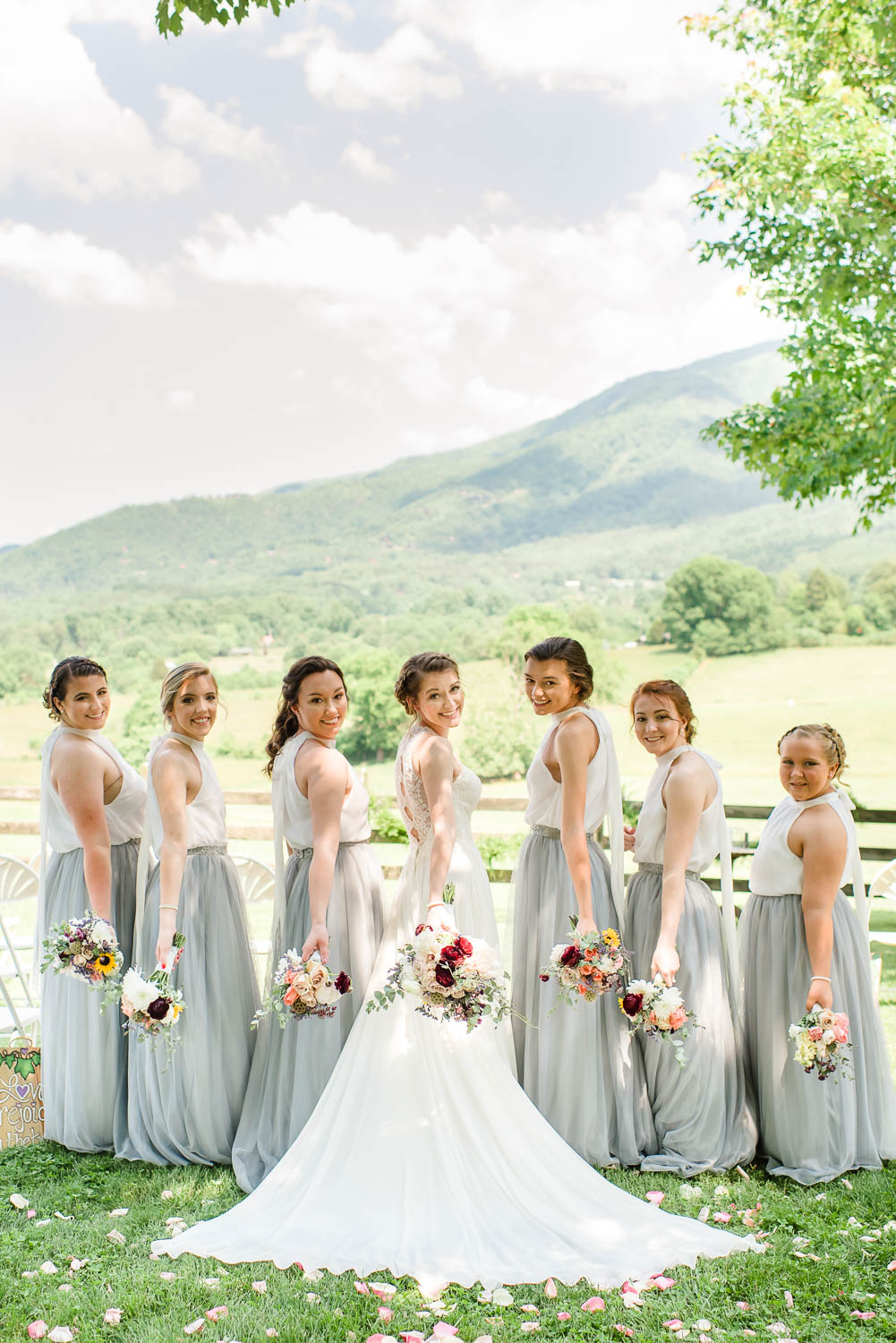 bridesmaids wearing long gray tulle skirts and white tops