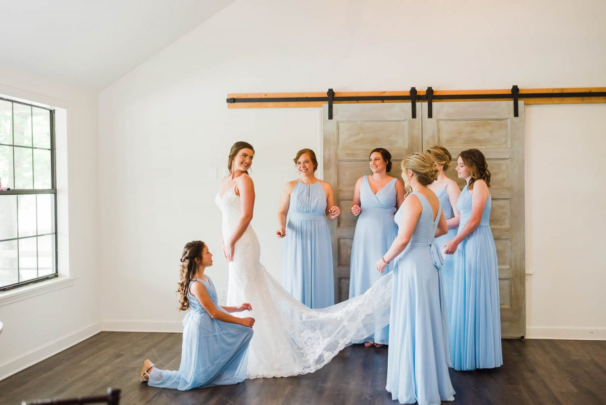 GIRLS IN ICE BLUE BRIDESMAIDS DRESSES and bride in white las=ce wedding dress