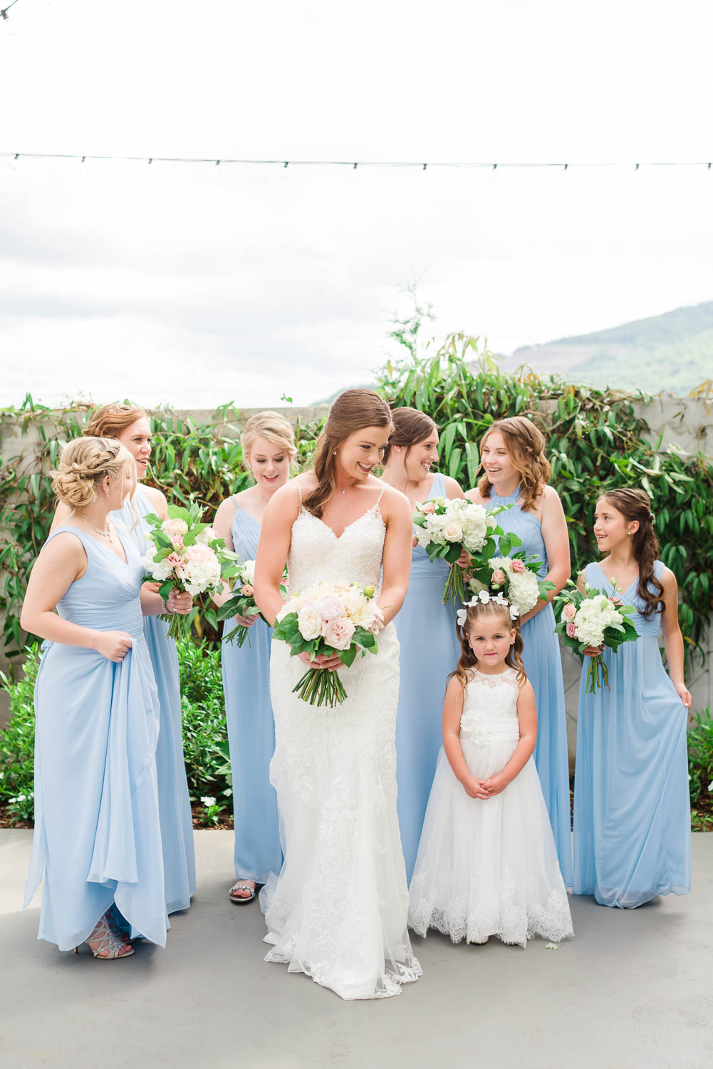 GIRLS OUTSIDE WEARING ICE BLUE BRIDESMAIDS DRESSES