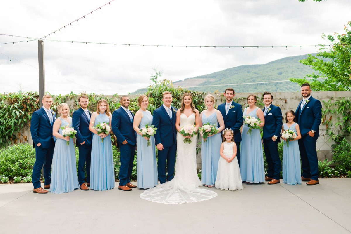 WEDDING PARTY WEARING NAVY BLUE SUITS AND ICE BLUE DRESSES