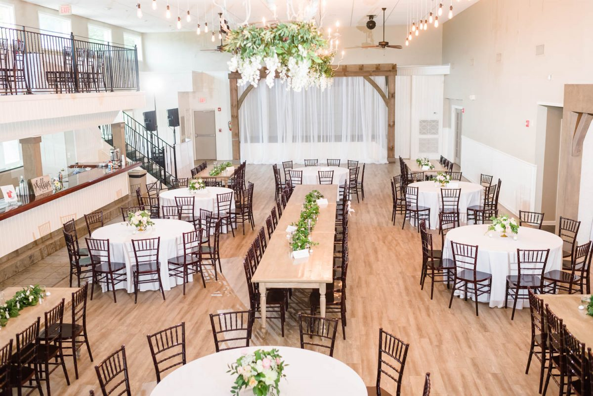 indoor reception decor with greenery on the chandeliers at the Venue Chattanooga