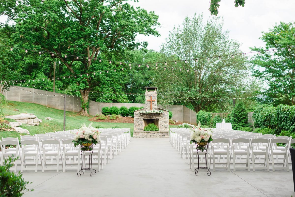 FLORAL ARRANGEMENTS ON STANDS AT OUTSIDE WEDDING CEREMONY