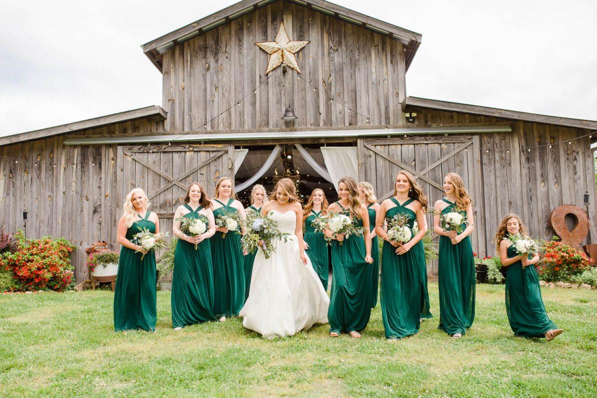 bridesmaids in peacock green long dresses
