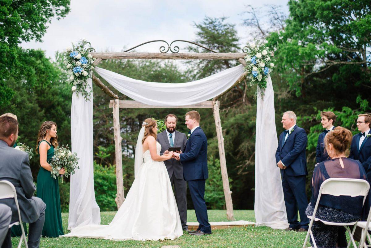 rustic outdoor wedding arbor