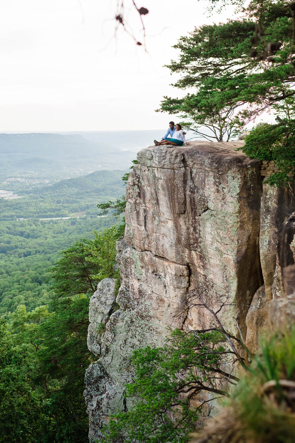 sunset rock in chattanooga with two people sitting on the top
