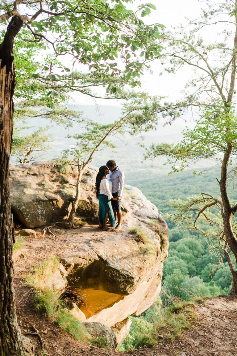 couple on clif at sunset rock in tennessee