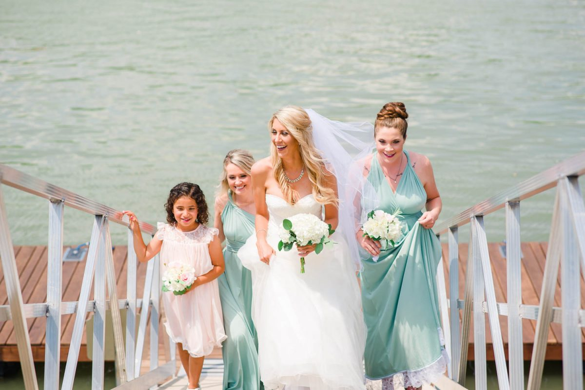 bridesmaids walking upp ramp from dock on Tennessee River