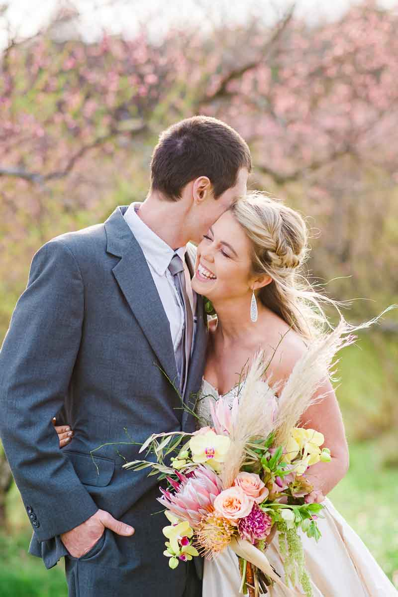 peach tree blossoms and bride and groom