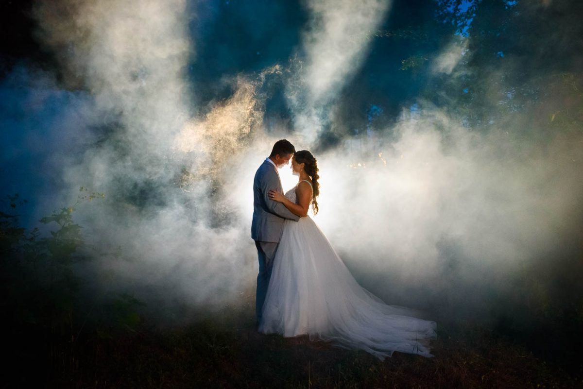 two people outside at night in smoke at Georgia Wedding
