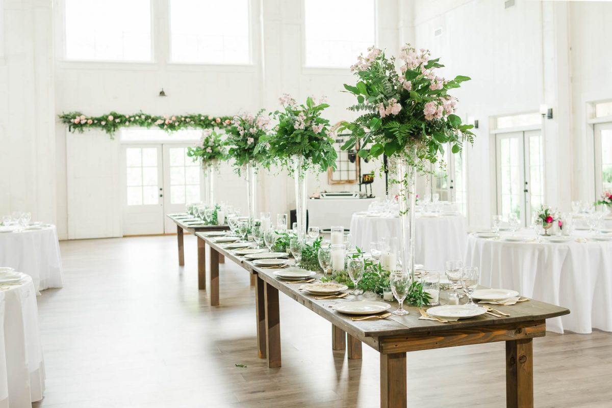 head table decorated with tall center pieces for georgia wedding