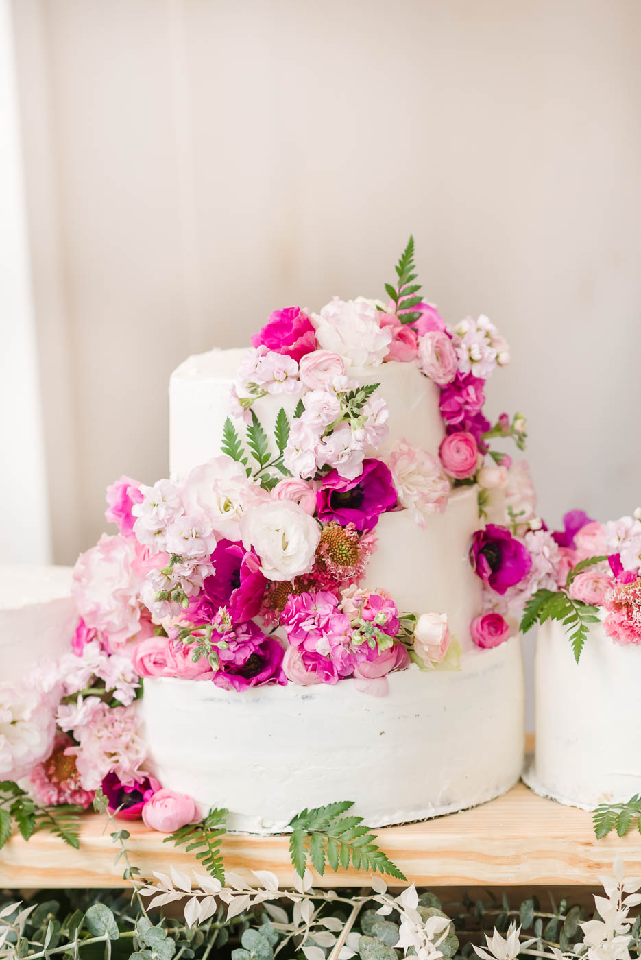 fuschia flowers on wedding cake in georgia