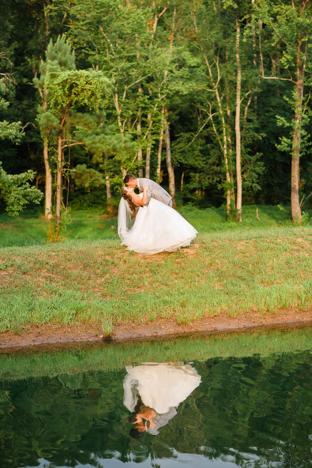 wedding couple and reflection in pond