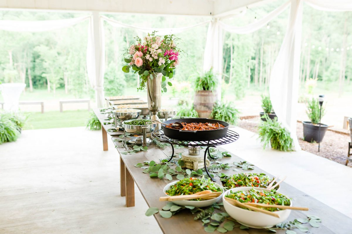 buffet table with fresh salads and tall cernter piece