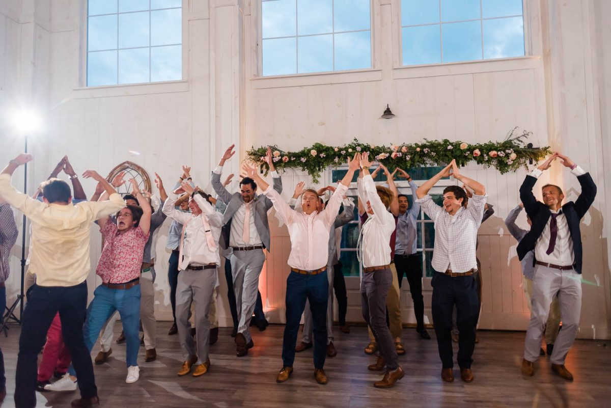 Wedding guests dancing to the YMCA