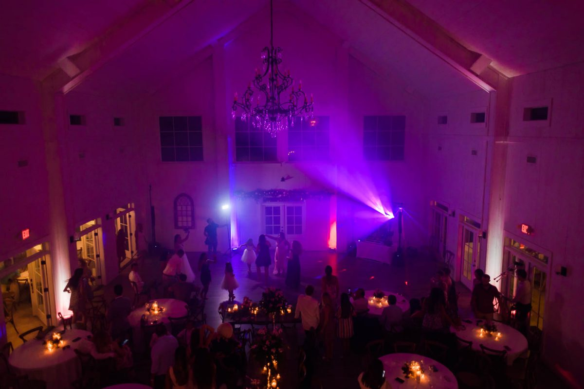 Purple uplighting on the dance floor at Circle B wedding Venue