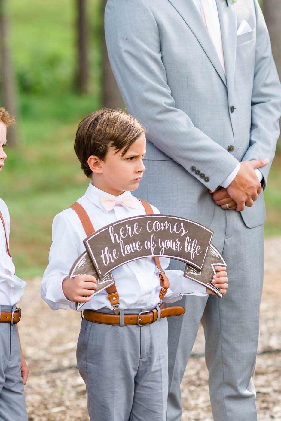 ring bearer with cute sign