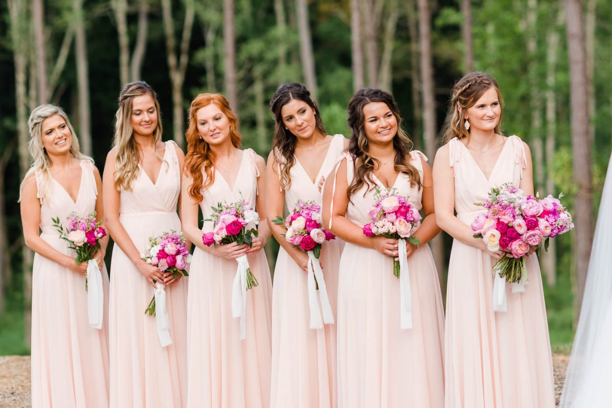 bridesmaids in blush dresses from Lulu's