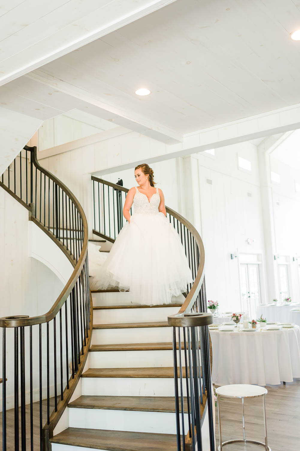 bride walking down curved stair case on Georgia