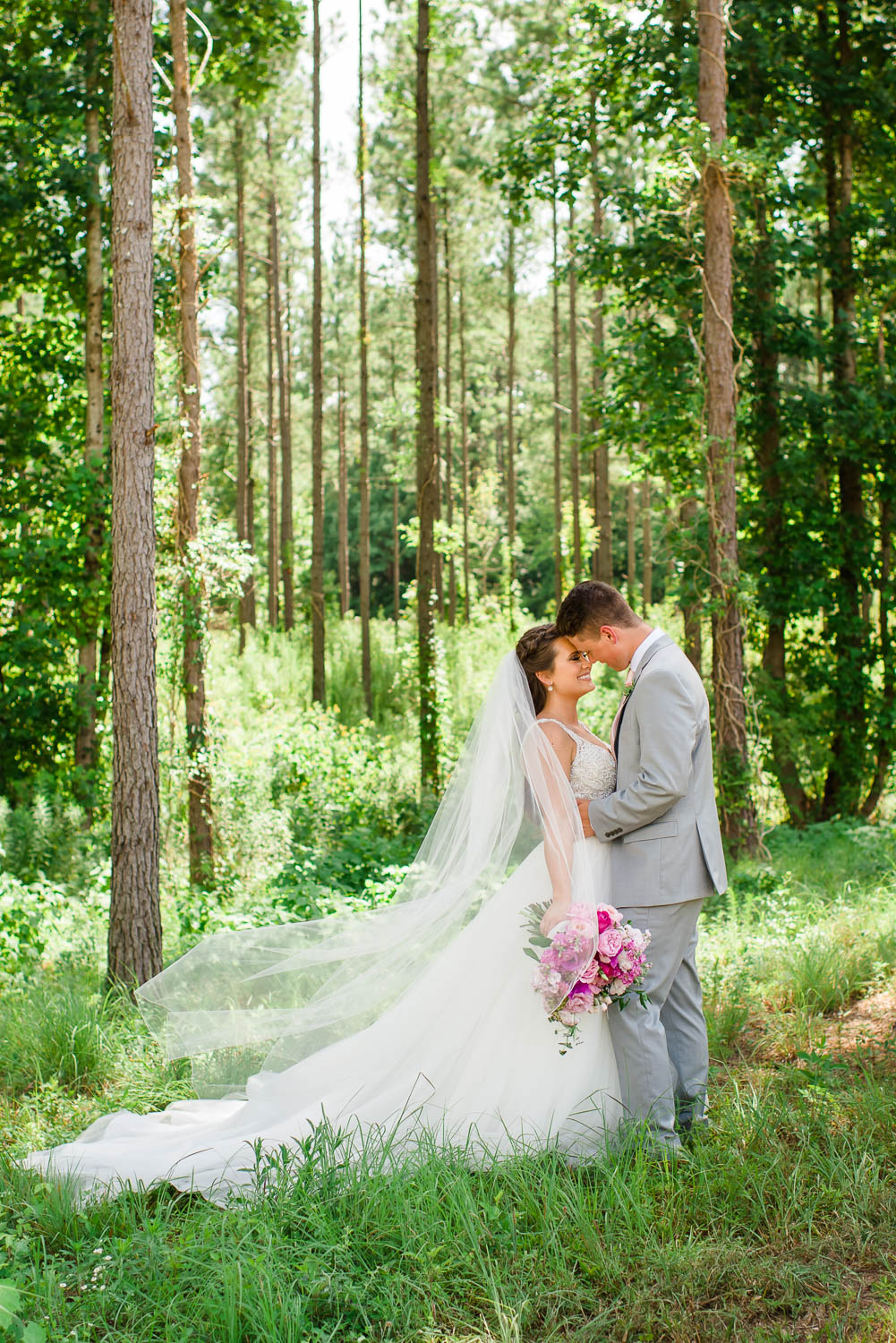 bride and groom in North Georgia pines on their wedding day