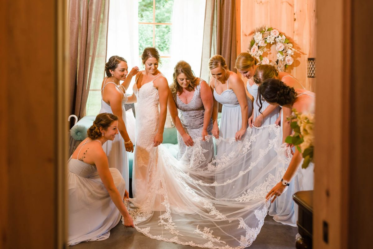 Bride in lace wedding dress with long lace train