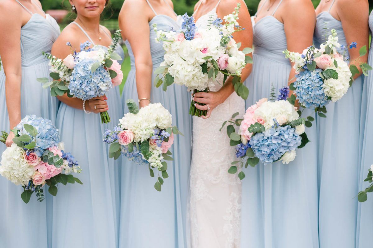 wedding flowers on blue bridesmaids dresses