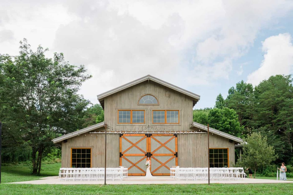 The Barn at 4Points Farm set up with white chairs out front for a wedding ceremony