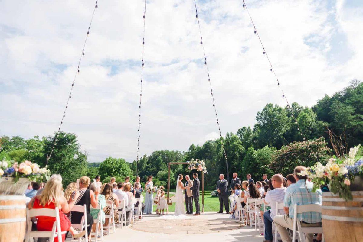 outdoor tennessee wedding ceremony inder string lights