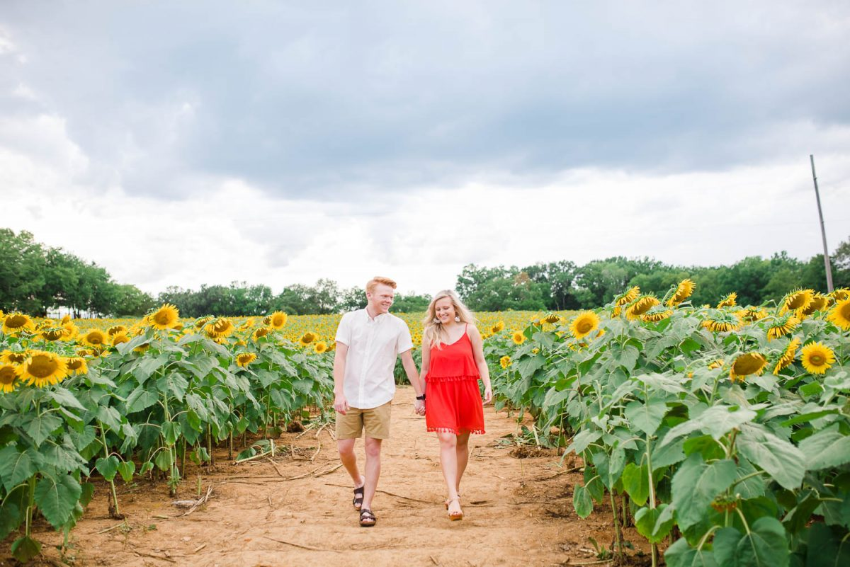 two people walking in funflower field in Ooltewah Tennessee
