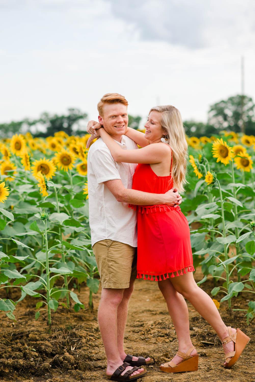 two people in sunflower field in Summer