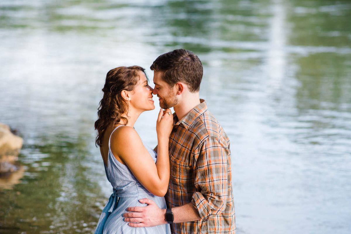 two people outside standing in the hiwassee river looking like a couplefrom the notebook