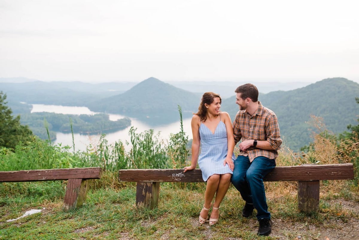 two people sitting outside talking with the Ocoee overlook view in the background