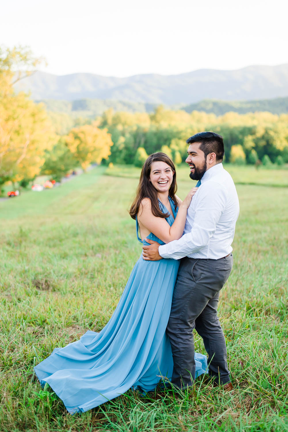 girl wearing blue dress from Lulus and guy wearing white shirt and gray pants