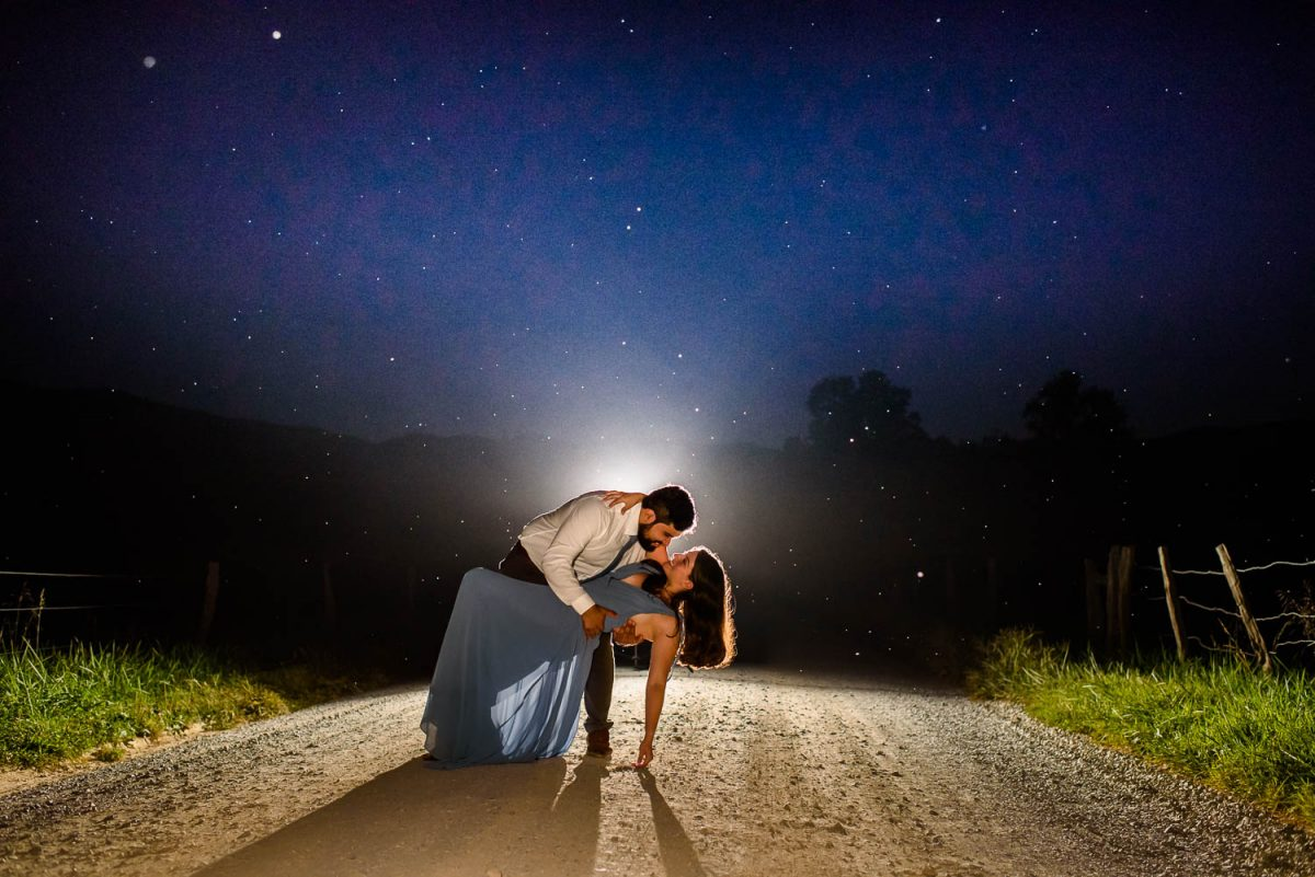 two people in the middle of a dirt road in TN at night looking like the belong on dancing with the stars!