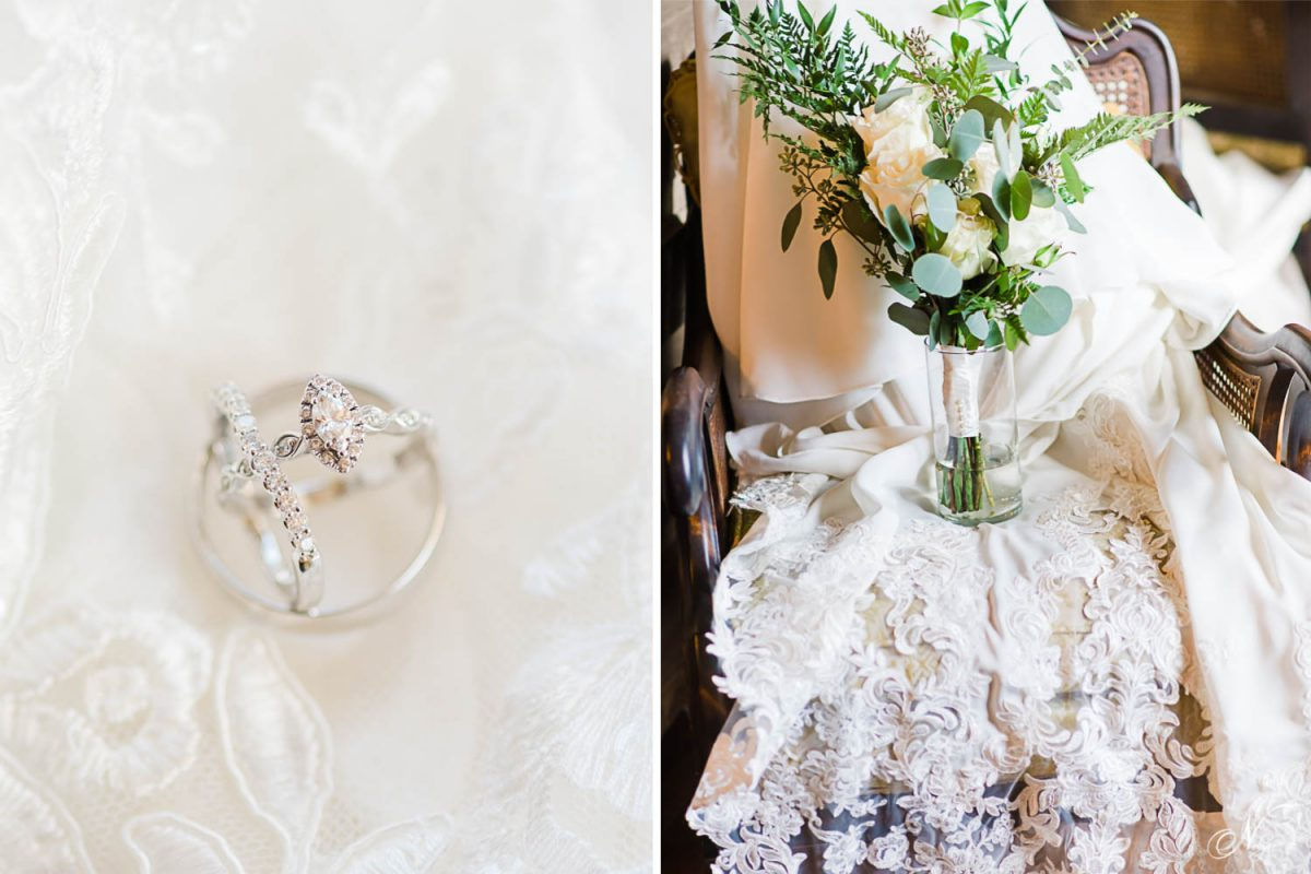 wedding rings on white lace background. And greenery and white bouquet