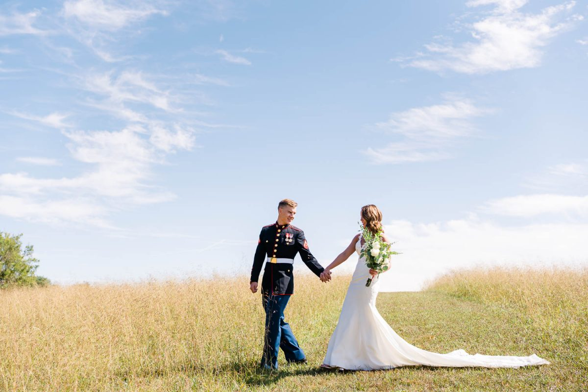 wedding couple outside with lots of blue sky