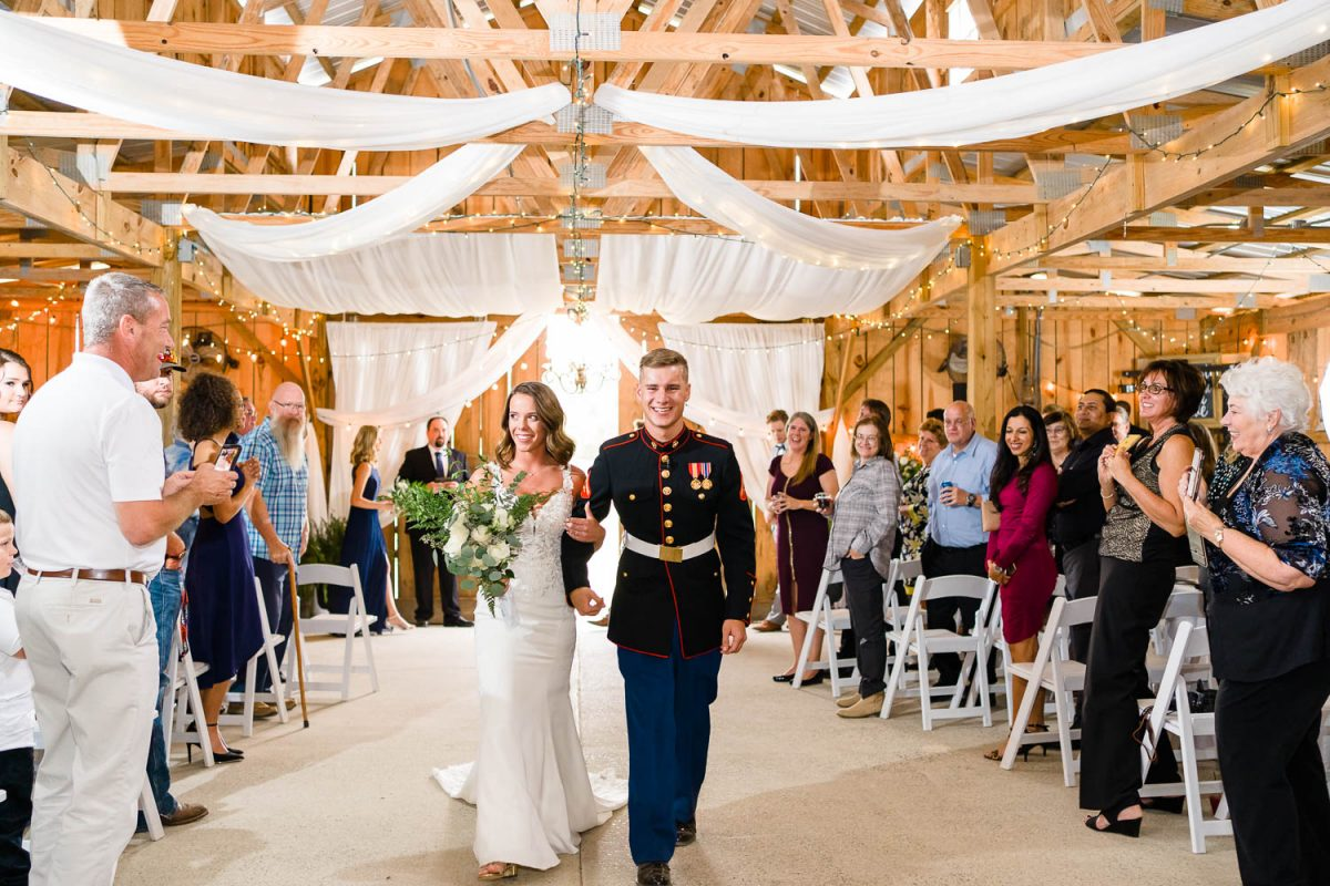 mappy couple just married walking down aisle