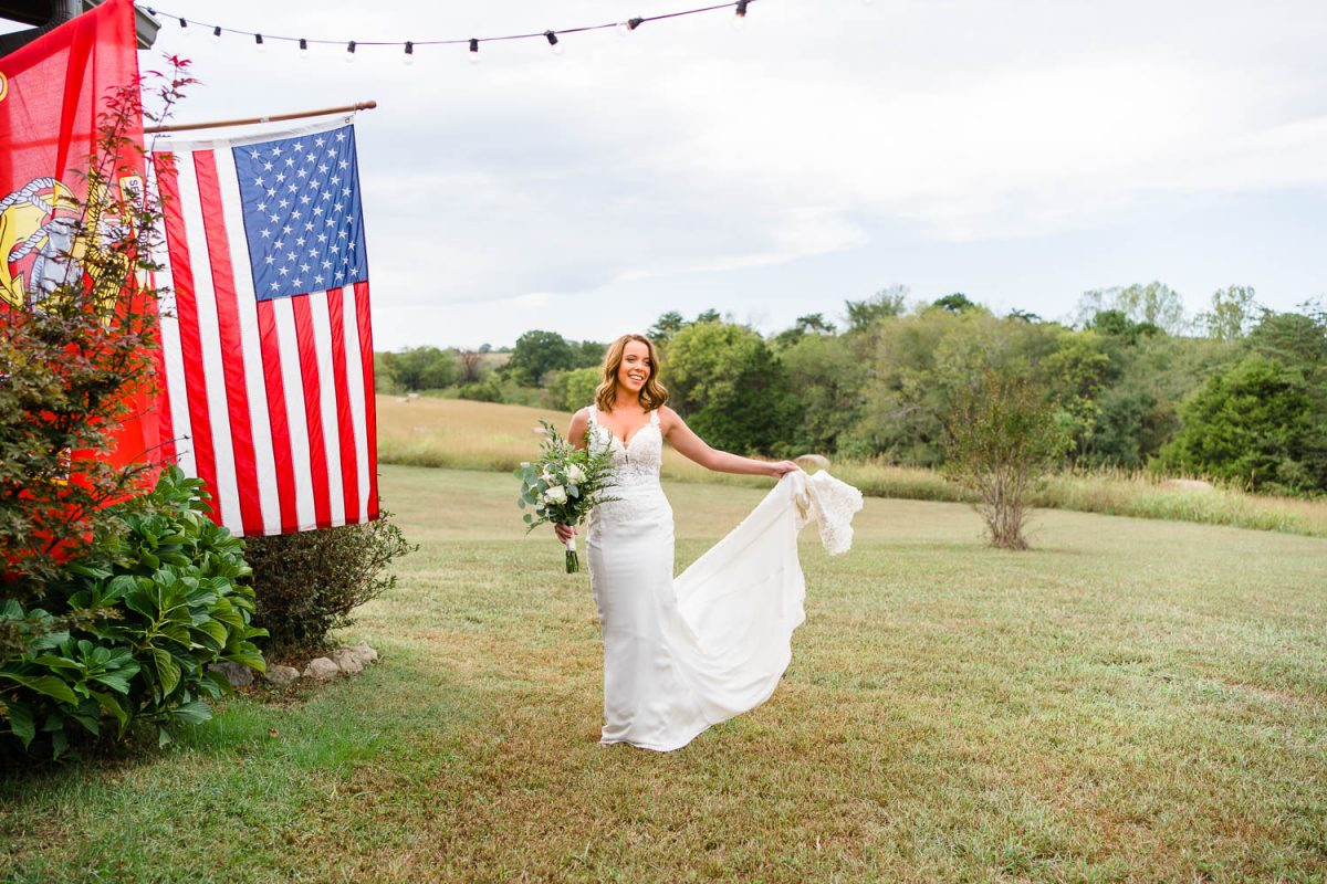 bride outside next to us flag