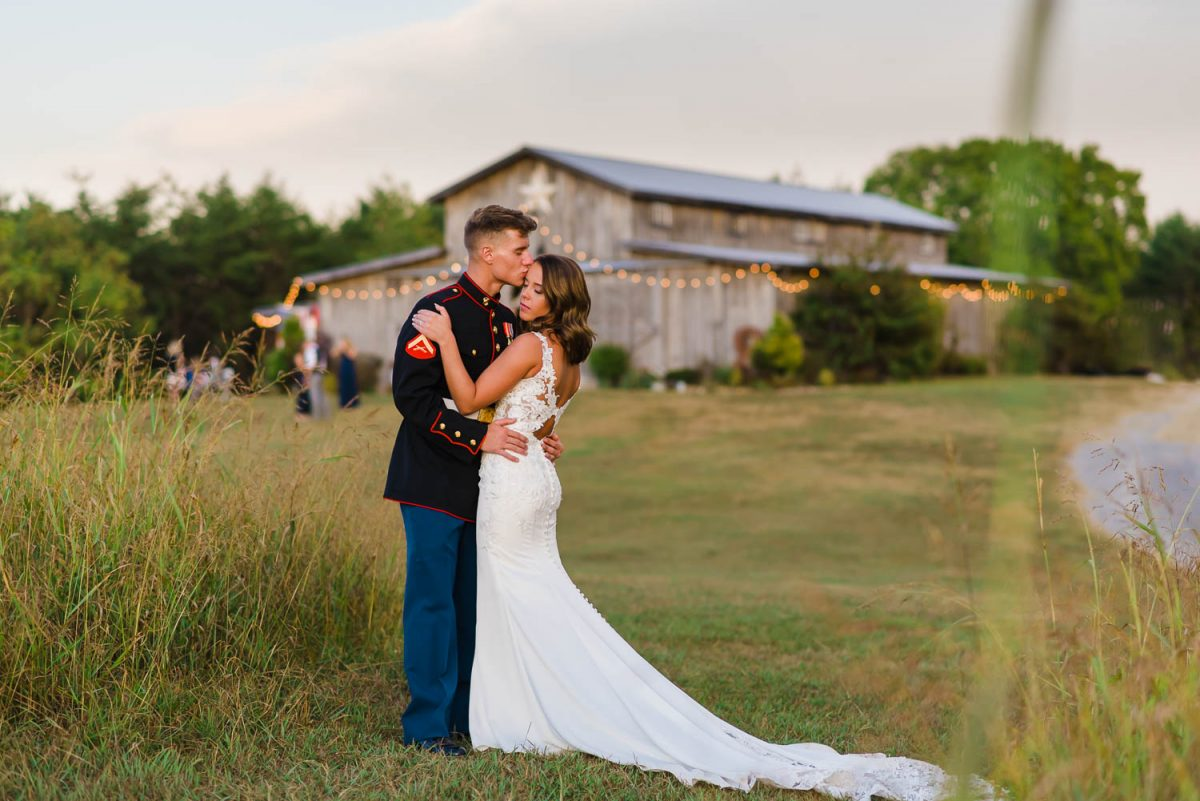 wedding couple with TN barn in the background