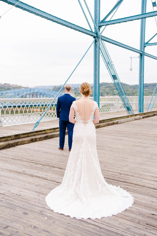 bride walking up to groom on Walnut street bridge in Chattanooga