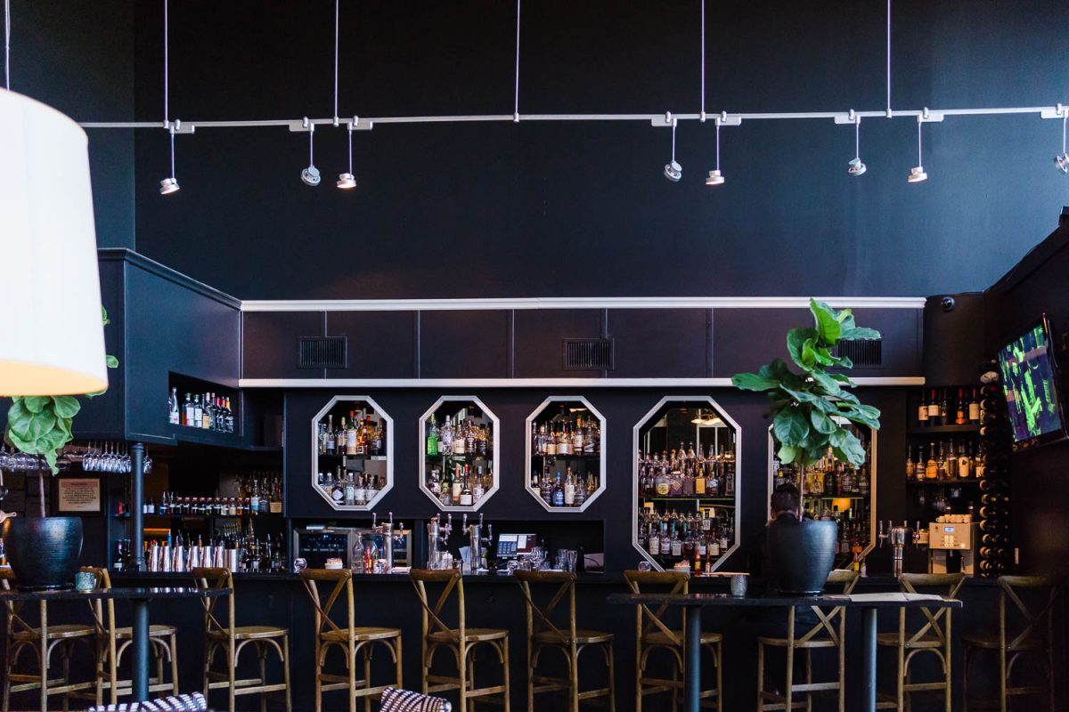 the bar with tall cross backed chairs