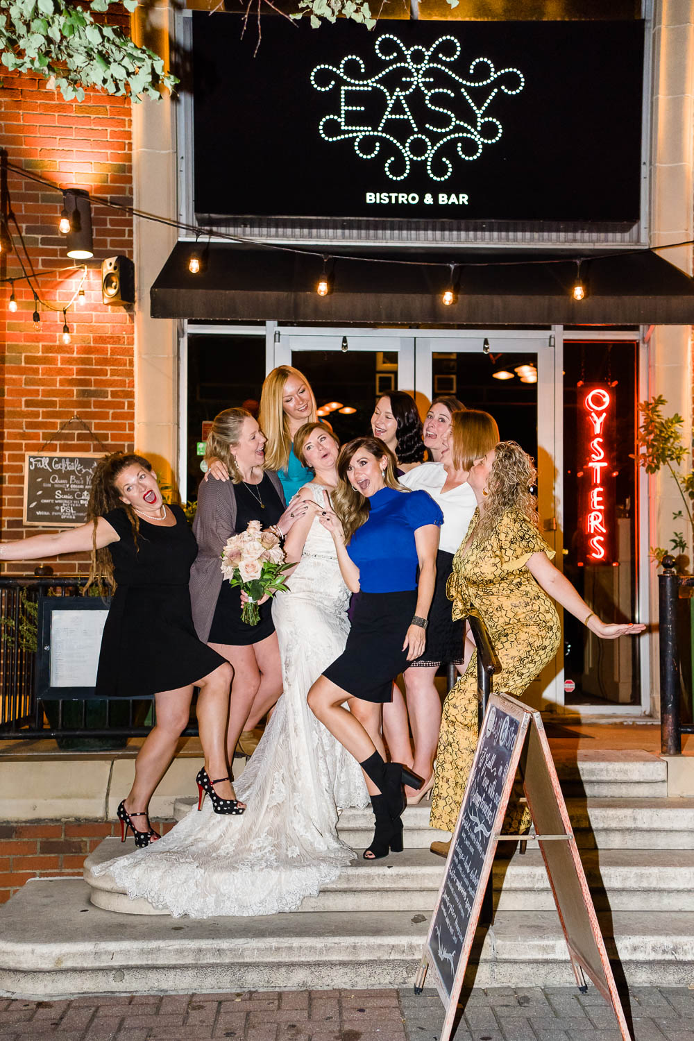 bride and friends standing on steps at Easy Bistro on Broad st Chattanooga