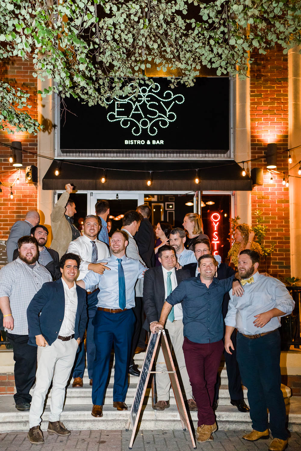 groom and friends on seteps at Easy Bistro in Chattanooga