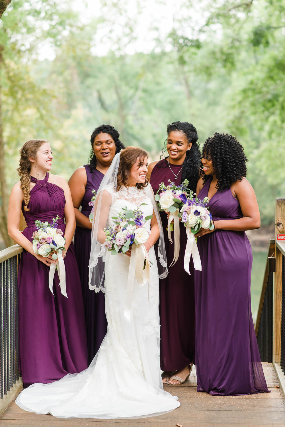bridal party in purple and plum