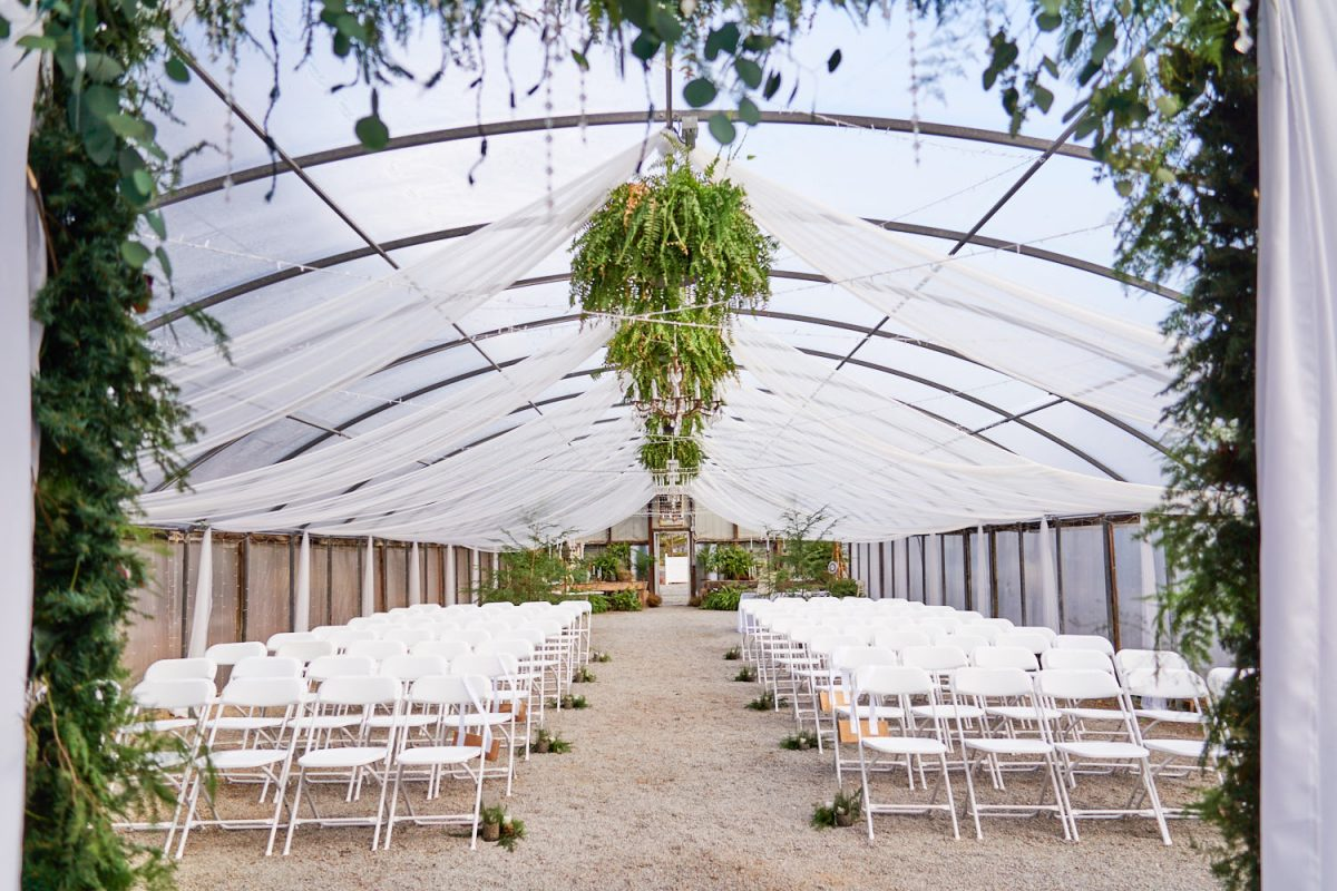 wedding ceremony setup in a greenhouse