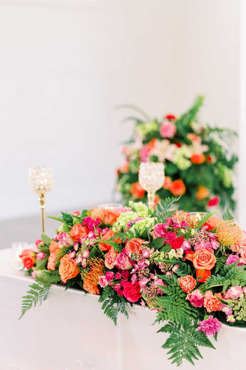 bold bright wedding flowers with pinks and coral