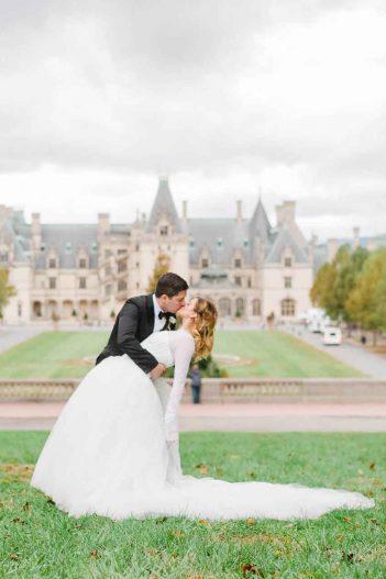 bride at Biltmore in princess dress and groom in black tie and suit