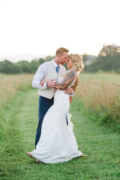 two married people in a big open field at sunset in east Tennessee